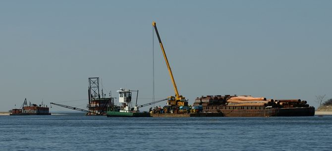 The dredge at the river\'s mouth.